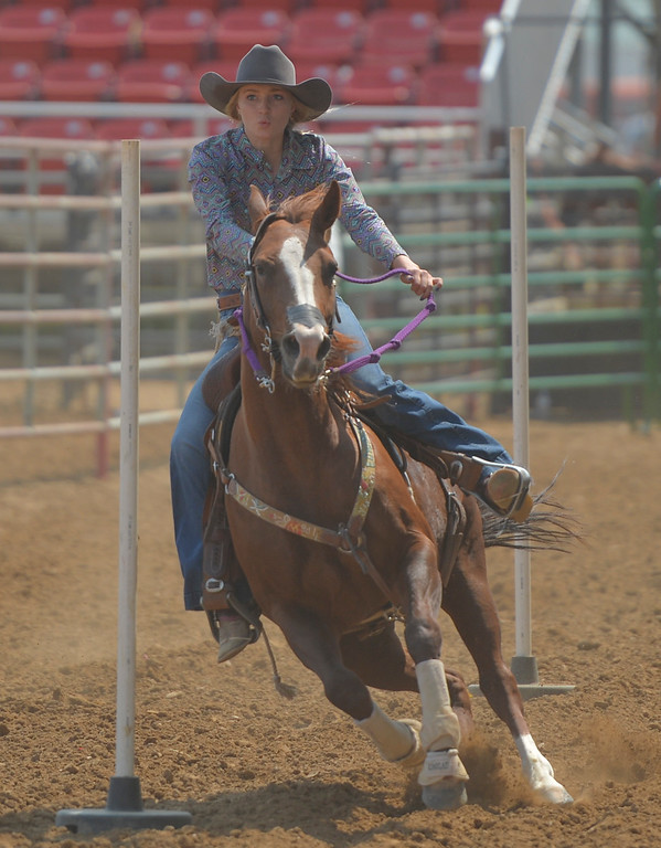 Justin Sheely | The Sheridan Press<br /> Kade Koltiska competes in Women's Pole Bending during the Sheridan County Rodeo Saturday at the Sheridan County Fairgrounds.