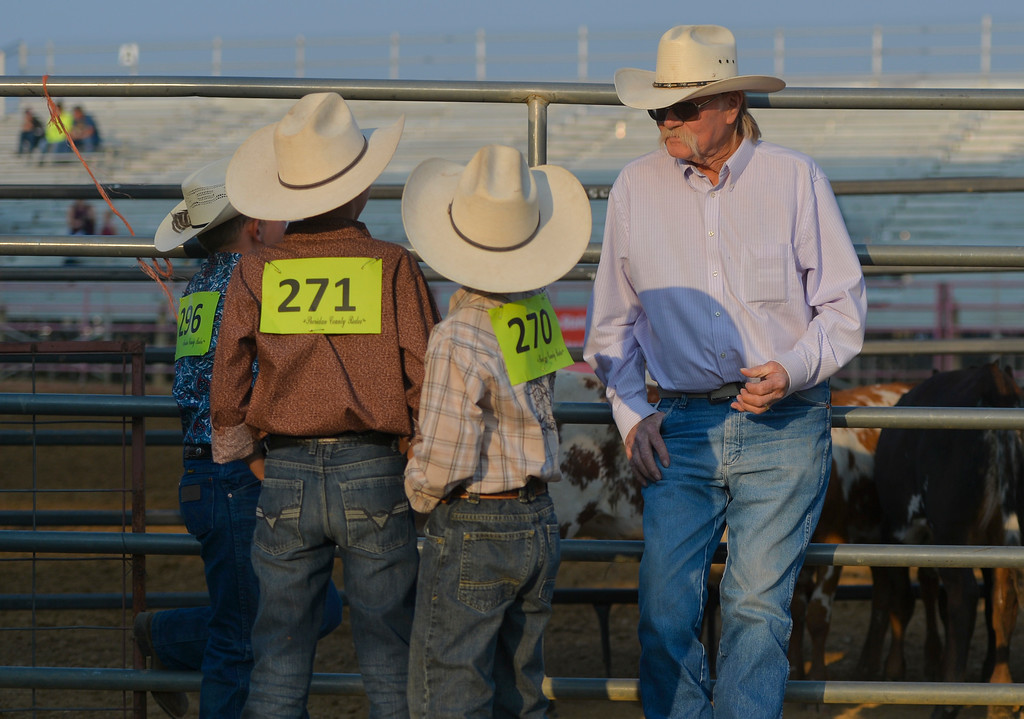 Justin Sheely | The Sheridan Press<br /> Bob Brownell offers some pointers to the young calf riders during the Sheridan County Rodeo Saturday at the Sheridan County Fairgrounds.