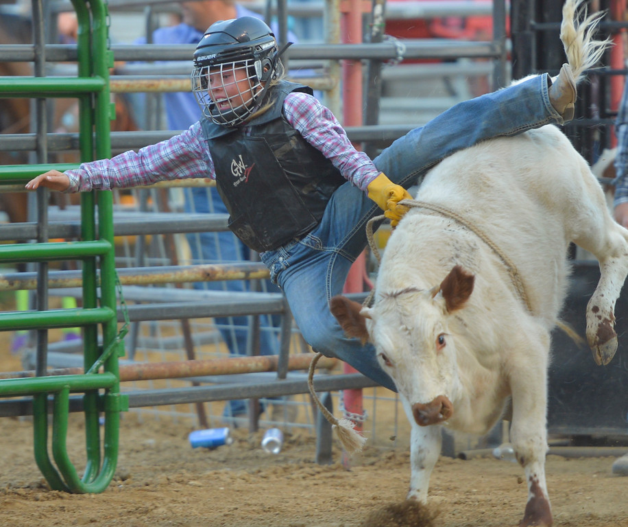 Justin Sheely | The Sheridan Press<br /> Quinn Harman competes in calf riding during the Sheridan County Rodeo Saturday at the Sheridan County Fairgrounds.
