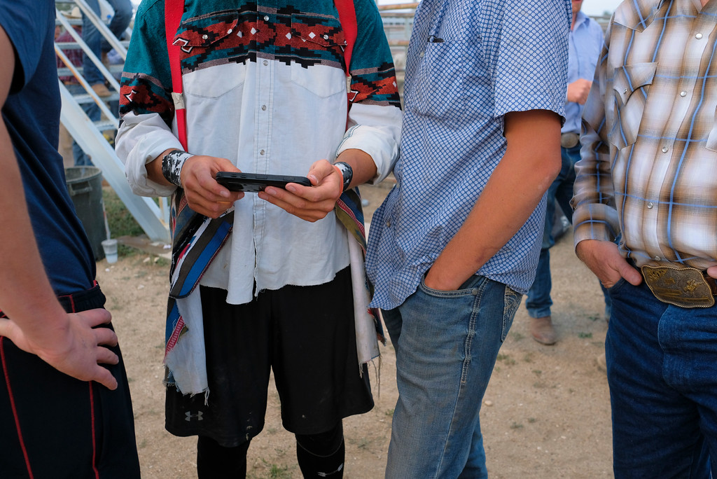 Justin Sheely | The Sheridan Press<br /> Bull riders review cellphone video of recent rides during the Sheridan County Rodeo Saturday at the Sheridan County Fairgrounds.