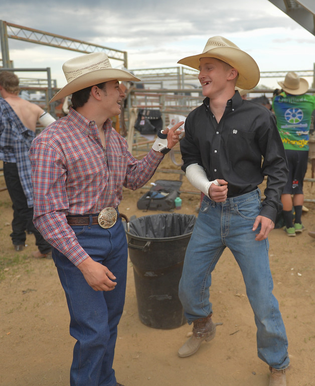 Justin Sheely | The Sheridan Press<br /> Local rodeo athlete Hunter Carlson, right, and his rodeo friend Lane McGehee keep the mood light before bareback riding during the Sheridan WYO Rodeo Saturday at the Sheridan County Fairgrounds.