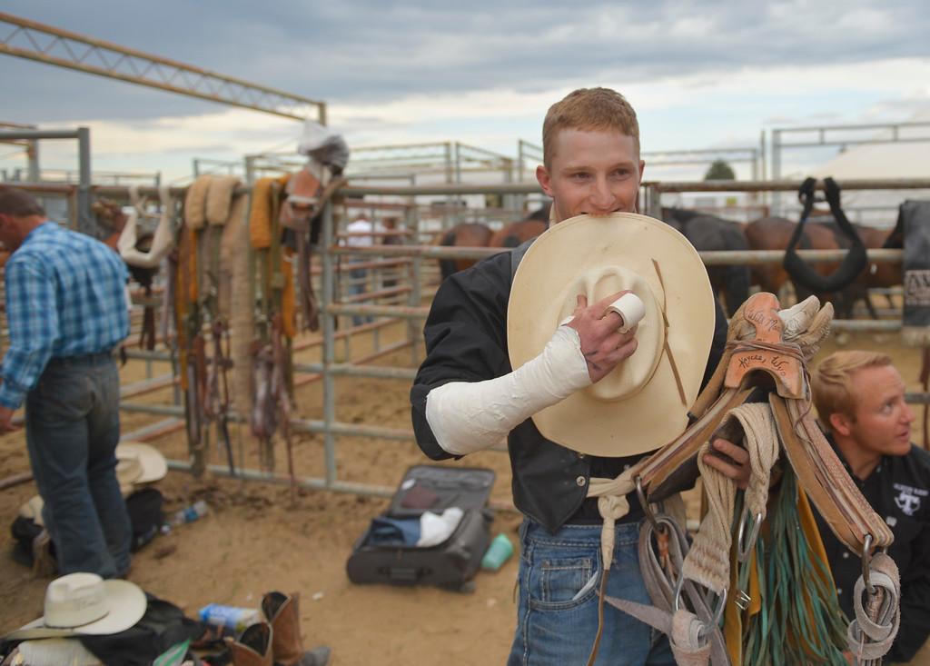 Justin Sheely   The Sheridan Press<br /> Hunter Carlson gathers his gear before bareback riding during the Sheridan WYO Rodeo Saturday at the Sheridan County Fairgrounds.