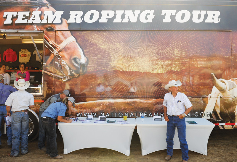 Mike Dunn | The Sheridan Press<br /> Kenny Knutson, right, stands by the sign in table for the Bob King Memorial Roping Sunday at the Sheridan County Fairgrounds. The annual event includes team ropers from across the region and pays respect to famous cowboy and rope maker Bob King.