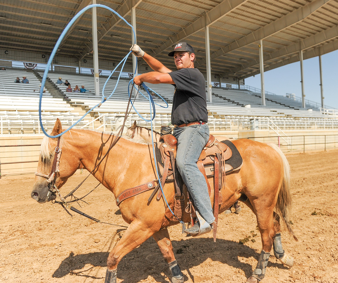 Mike Dunn | The Sheridan Press<br /> Riley Curuchet, of Kaycee, swings his rope after his run during the Bob King Memorial Roping Sunday at the Sheridan County Fairgrounds. The annual event includes team ropers from across the region and pays respect to famous cowboy and rope maker Bob King.