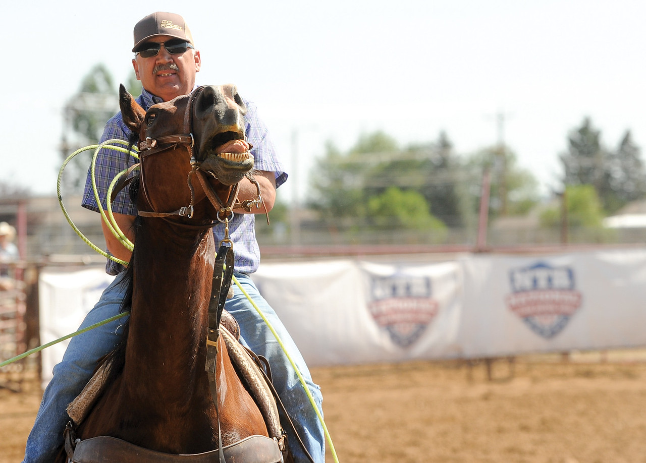 Mike Dunn | The Sheridan Press <br /> Ken Balkenbush pulls on the reins after roping the heel of a calf during the Bob King Memorial Roping Sunday at the Sheridan County Fairgrounds. The annual event includes team ropers from across the region and pays respect to famous cowboy and rope maker Bob King.