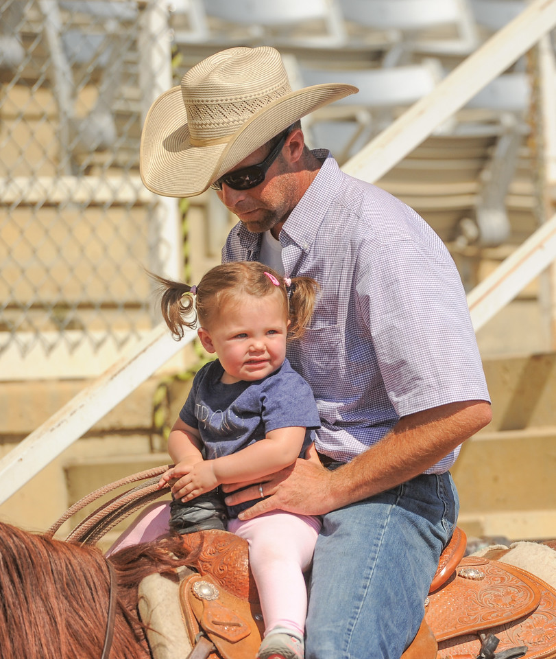 Mike Dunn | The Sheridan Press <br /> Casey Teichert, right, rides with his daughter Taylor during the Bob King Memorial Roping Sunday at the Sheridan County Fairgrounds. The annual event includes team ropers from across the region and pays respect to famous cowboy and rope maker Bob King.