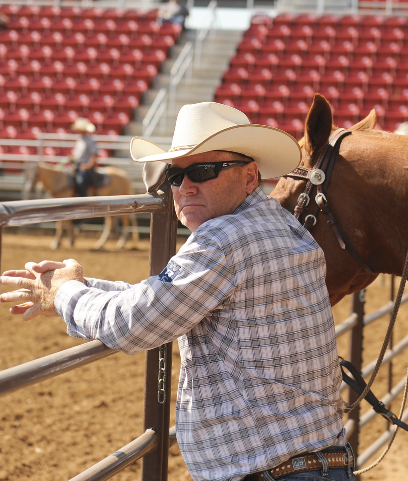 Mike Dunn | The Sheridan Press <br /> Rob Erickson, of Billings, leans against the railing after his ride during the Bob King Memorial Roping Sunday at the Sheridan County Fairgrounds. The annual event includes team ropers from across the region and pays respect to famous cowboy and rope maker Bob King.