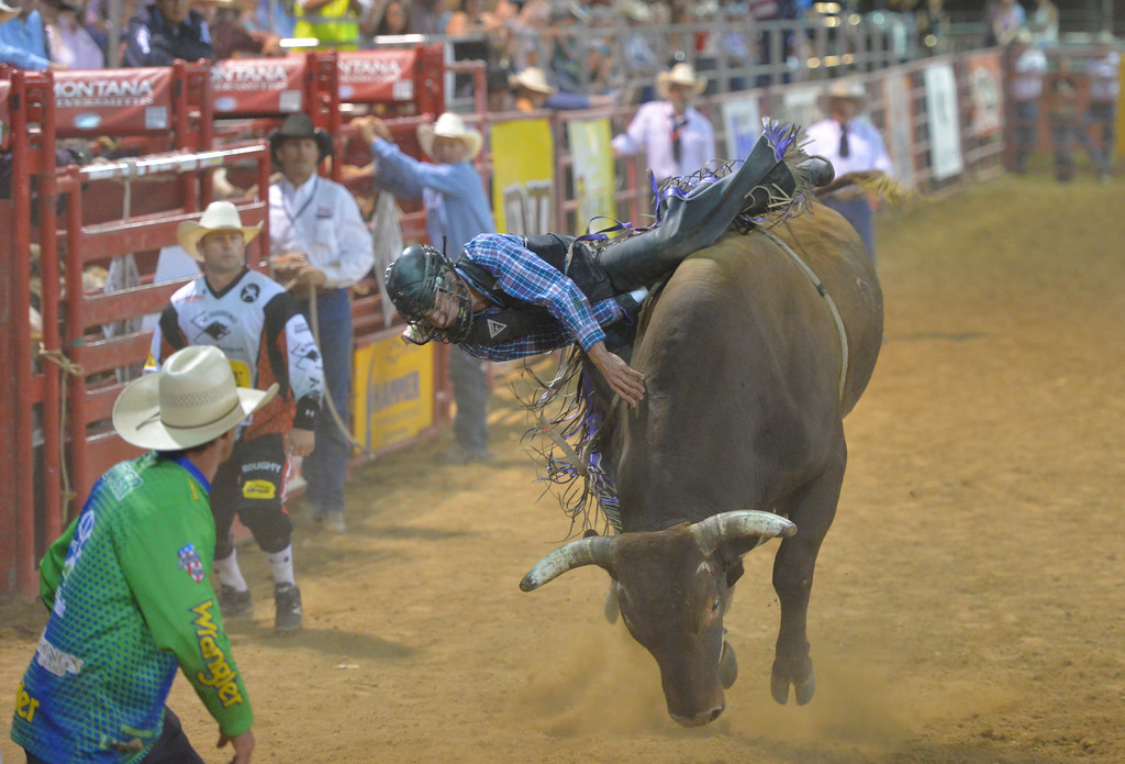 Justin Sheely | The Sheridan Press<br /> Koby Radley of Montpelier, Louisiana, is spun off the bull during the Sheridan WYO Rodeo Saturday at the Sheridan County Fairgrounds.