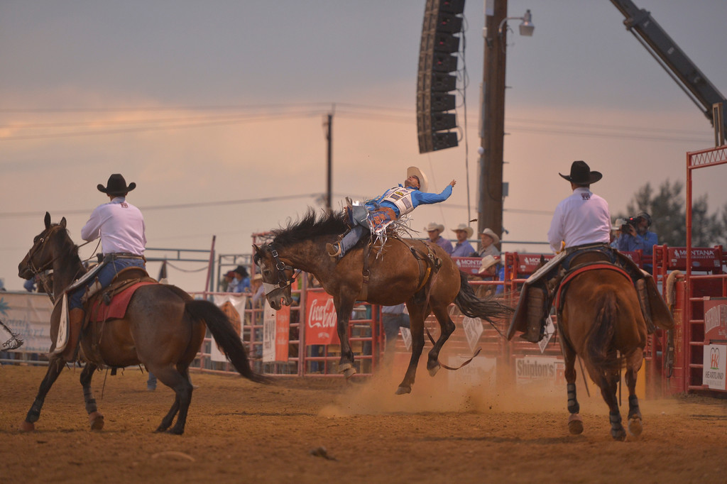 Justin Sheely | The Sheridan Press<br /> Heath DeMoss of Heflin, Louisiana, gets some air in saddle bronc riding during the Sheridan WYO Rodeo Saturday at the Sheridan County Fairgrounds.