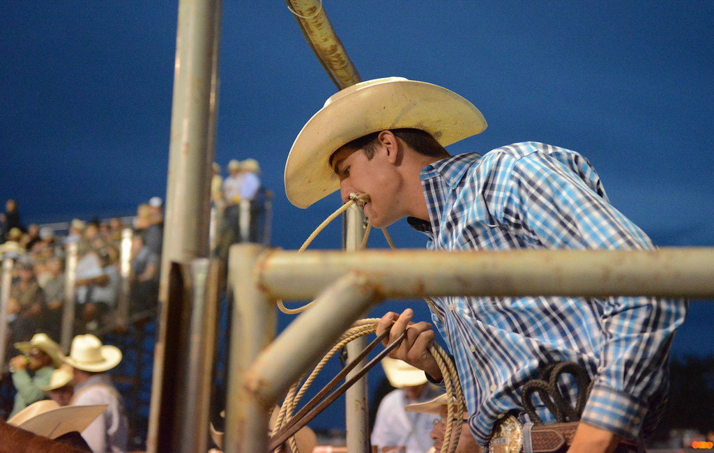 Justin Sheely | The Sheridan Press<br /> Justin Smith of Leesville, Louisiana, leads his horse besides the roping chute for tie-down roping during the Sheridan WYO Rodeo Saturday at the Sheridan County Fairgrounds.