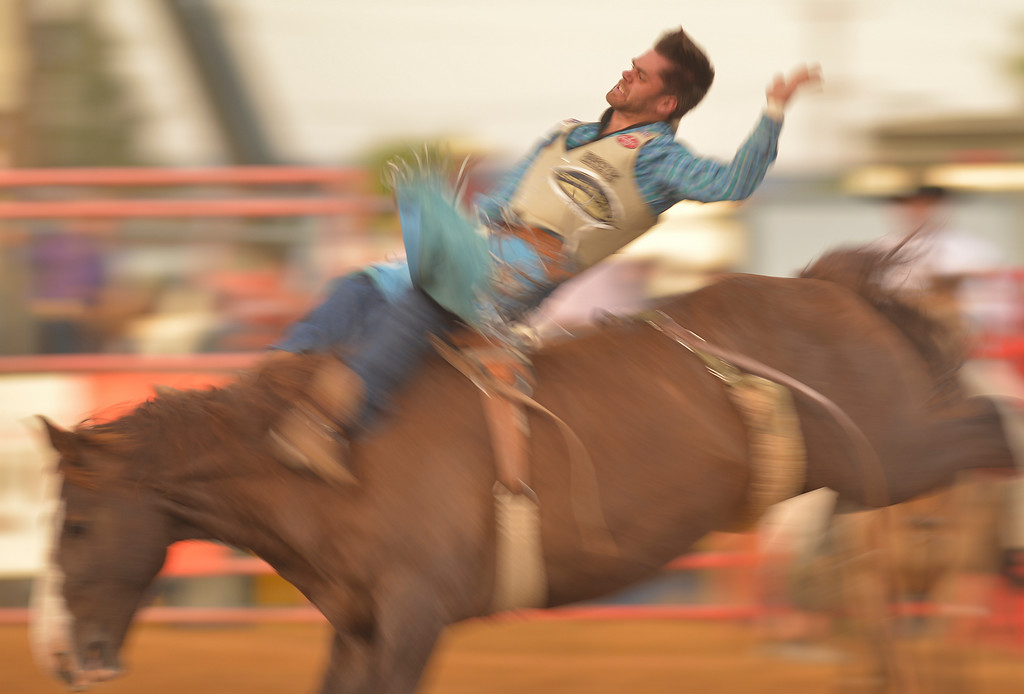 Justin Sheely | The Sheridan Press<br /> Luke Creasy of Lovington, New Mexico, rides bareback during the Sheridan WYO Rodeo Saturday at the Sheridan County Fairgrounds.