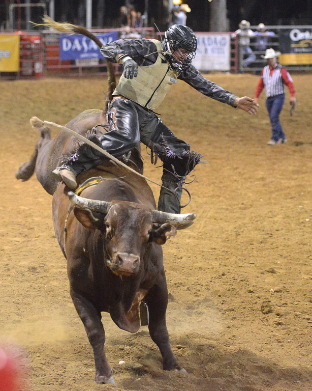 Justin Sheely   The Sheridan Press<br /> Cordell Curtis of Monte Vista, Colorado, is tossed from the bull during the Sheridan WYO Rodeo Wednesday at the Sheridan County Fairgrounds.