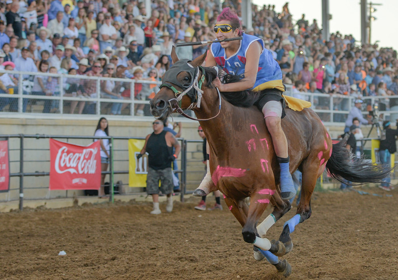 Justin Sheely | The Sheridan Press<br /> Wes Edwards of team Rides a Pretty Horse takes off in the 1st heat of the Indian Relay Races during the Sheridan WYO Rodeo Wednesday at the Sheridan County Fairgrounds.