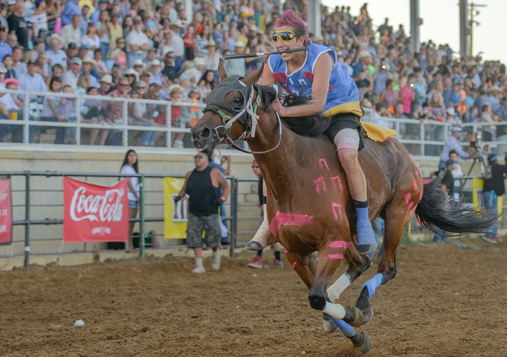 Justin Sheely   The Sheridan Press<br /> Wes Edwards of team Rides a Pretty Horse takes off in the 1st heat of the Indian Relay Races during the Sheridan WYO Rodeo Wednesday at the Sheridan County Fairgrounds.