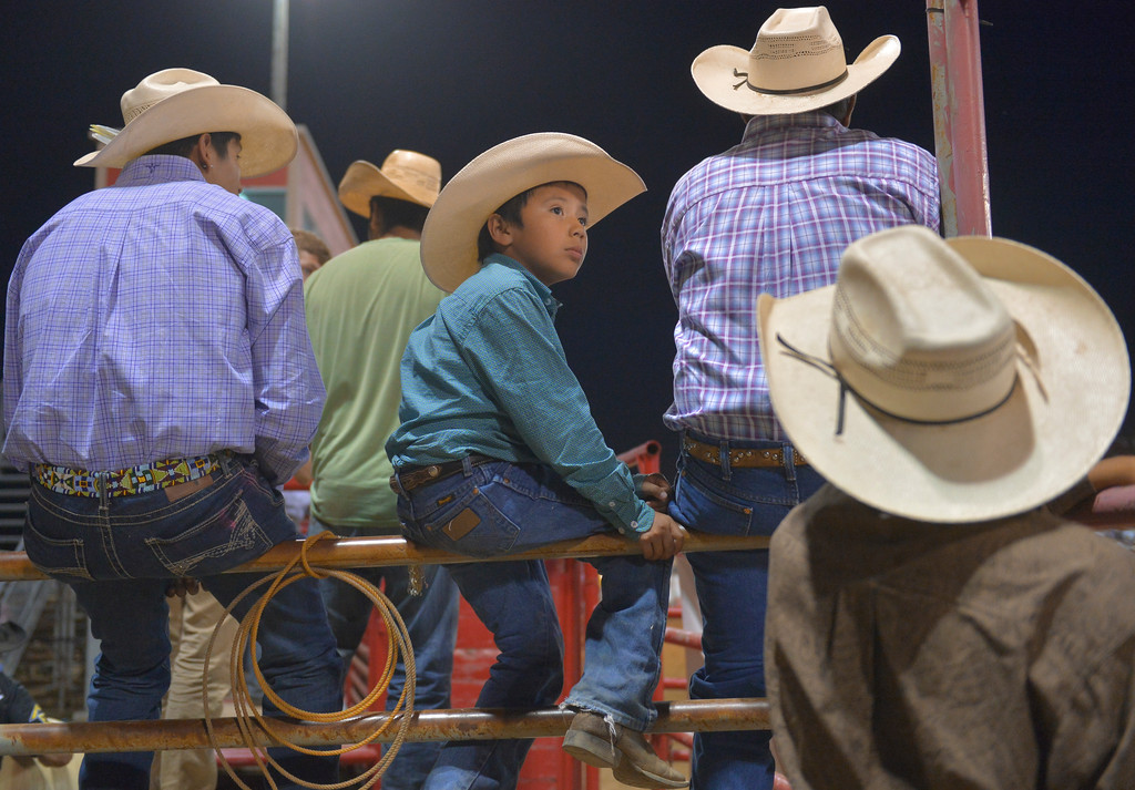 Justin Sheely   The Sheridan Press<br /> Seven-year-old Kennon Pretty Weasel watches the action from the fence during the Sheridan WYO Rodeo Wednesday at the Sheridan County Fairgrounds.