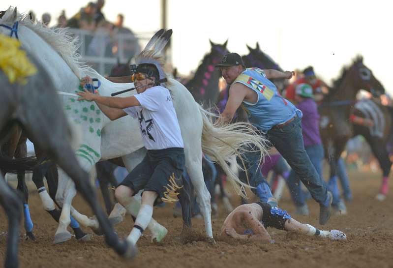 Justin Sheely | The Sheridan Press<br /> The chaos of multiple horses and handlers as jockies exchange horses in the 1st heat of the Indian Relay Races during the Sheridan WYO Rodeo Wednesday at the Sheridan County Fairgrounds.