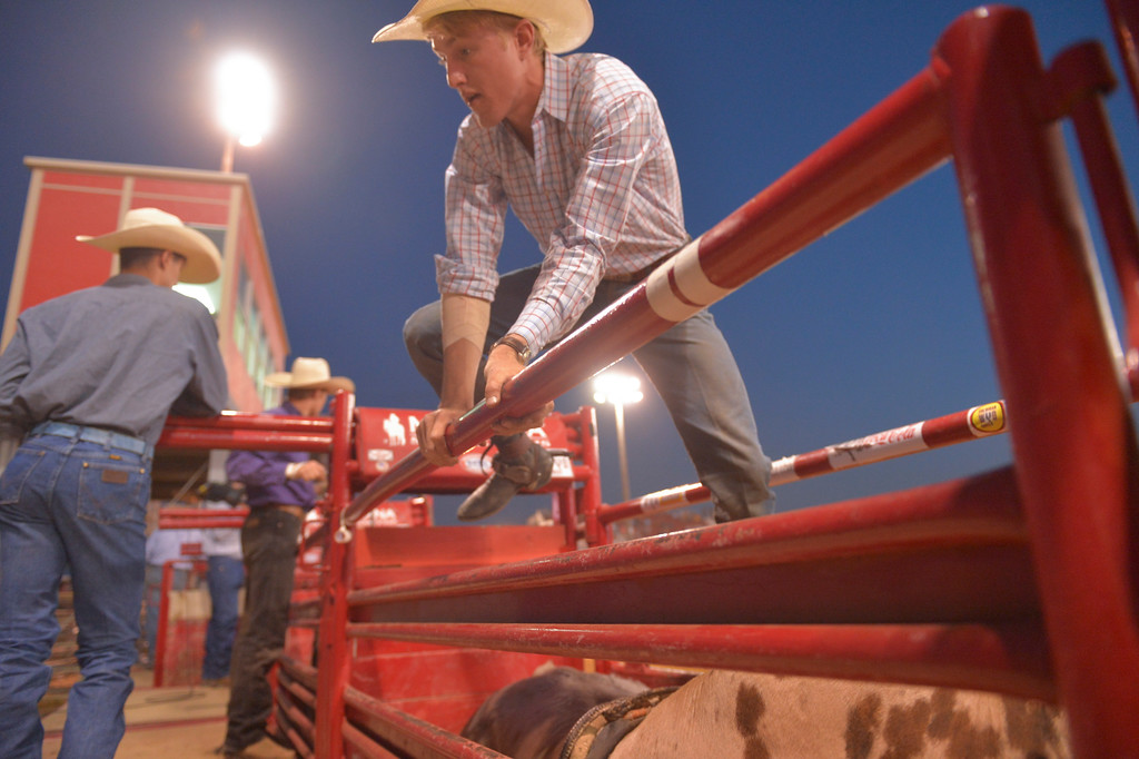 Justin Sheely   The Sheridan Press<br /> Brady Portenier of Caldwell, Idaho, gets ready for bull riding during the Sheridan WYO Rodeo Wednesday at the Sheridan County Fairgrounds.