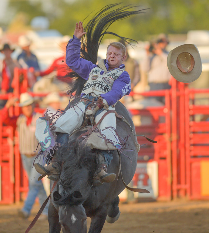 Justin Sheely   The Sheridan Press<br /> JR Vezain of Cowley, Wyoming, competes in bareback riding during the Sheridan WYO Rodeo Wednesday at the Sheridan County Fairgrounds.