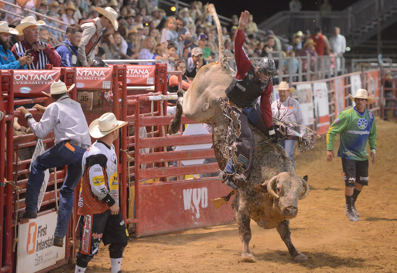 Justin Sheely | The Sheridan Press<br /> Boudreaux Campbell of Crockett, Texas, competes in bull riding during the Sheridan WYO Rodeo Wednesday at the Sheridan County Fairgrounds.