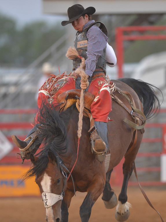 Justin Sheely   The Sheridan Press<br /> Layton Green of Alabama competes in saddle bronc riding during the Sheridan WYO Rodeo Wednesday at the Sheridan County Fairgrounds.