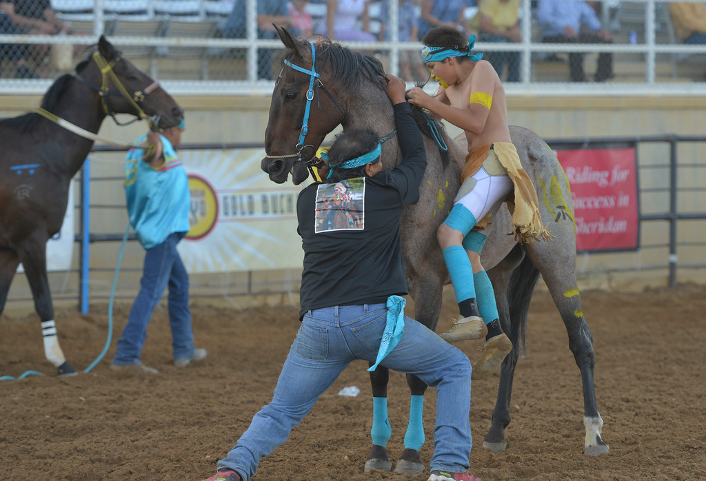 Justin Sheely   The Sheridan Press<br /> Catcher His Bad Horse exchanges horses in the 1st heat of the Indian Relay Races during the Sheridan WYO Rodeo Wednesday at the Sheridan County Fairgrounds.
