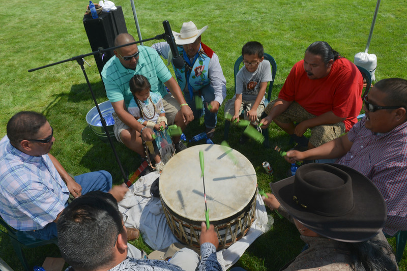 "Justin Sheely | The Sheridan Press <br /> Members of the Crow ""Song Doggs Singers"" sing and beat the drum during the First People's Powwow Wednesday at the Historic Sheridan Inn. The culminating event is Friday after the Sheridan WYO Rodeo Parade."
