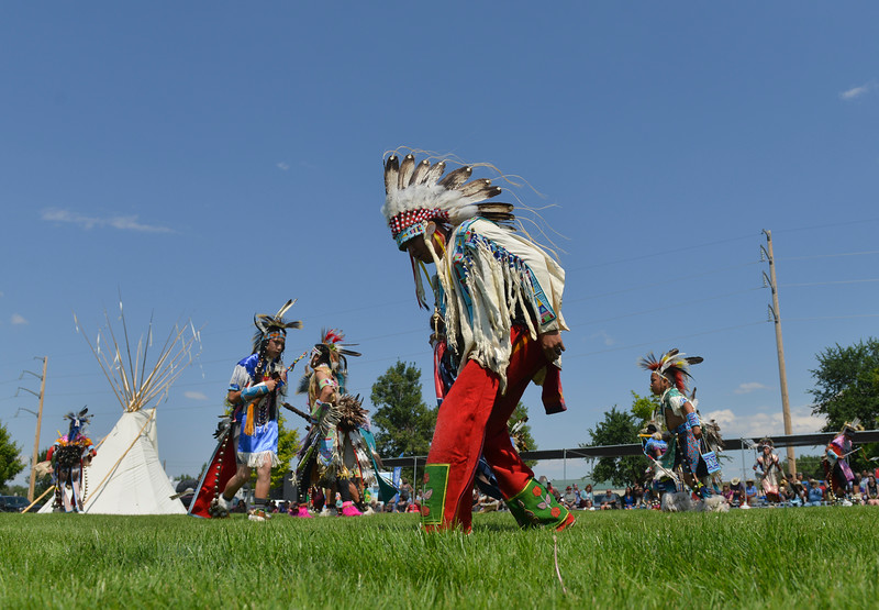 Justin Sheely | The Sheridan Press <br /> Crow dancers display their art on the field during the First People's Powwow Wednesday at the Historic Sheridan Inn. The culminating event is Friday after the Sheridan WYO Rodeo Parade.
