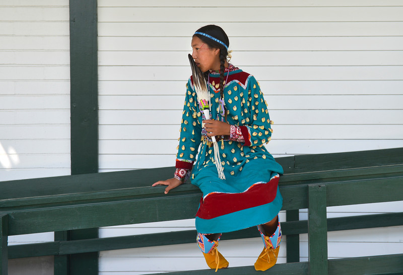 Justin Sheely | The Sheridan Press <br /> Thirteen-year-old Berdina Dawes takes a break from the heat during the First People's Powwow Wednesday at the Historic Sheridan Inn. The culminating event is Friday after the Sheridan WYO Rodeo Parade.