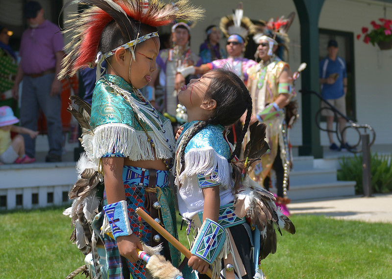 Justin Sheely | The Sheridan Press <br /> Seven-year-old Blake Iron, left, and Jericho Bull Weasel play during the First People's Powwow Wednesday at the Historic Sheridan Inn. The culminating event is Friday after the Sheridan WYO Rodeo Parade.