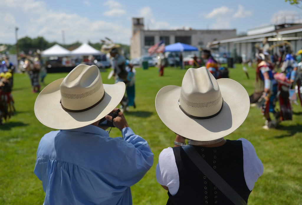 Justin Sheely | The Sheridan Press <br /> Tourists take photos of the dancers during the First People's Powwow Wednesday at the Historic Sheridan Inn. The culminating event is Friday after the Sheridan WYO Rodeo Parade.