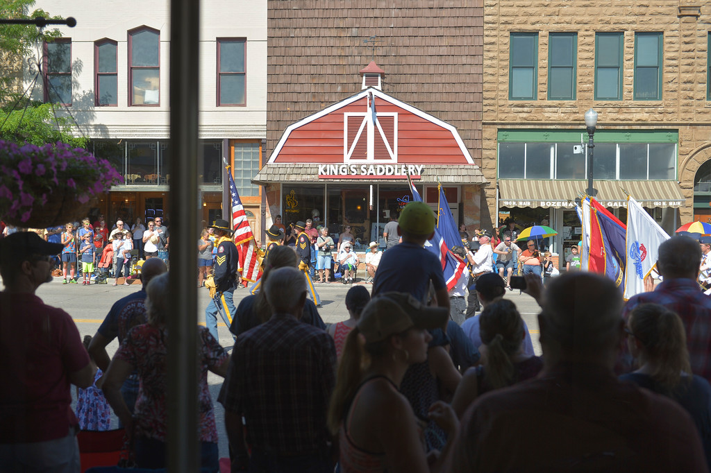 Justin Sheely | The Sheridan Press<br /> Parade goers look on as the Drum and Bugle Corps marches by during the Sheridan WYO Rodeo Parade Friday morning on Main Street.