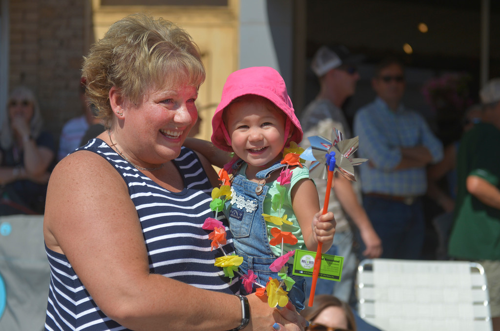 "Justin Sheely | The Sheridan Press<br /> Lori ""Aunt Lulu"" Ostendorf holds her two-year-old niece Aria Bealer during the Sheridan WYO Rodeo Parade Friday morning on Main Street."