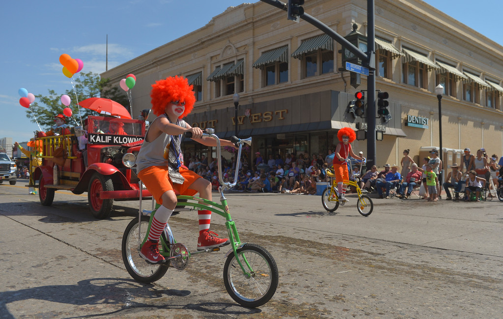 Justin Sheely | The Sheridan Press<br /> Kalif Shrine klowns ride bikes during the Sheridan WYO Rodeo Parade Friday morning on Main Street.