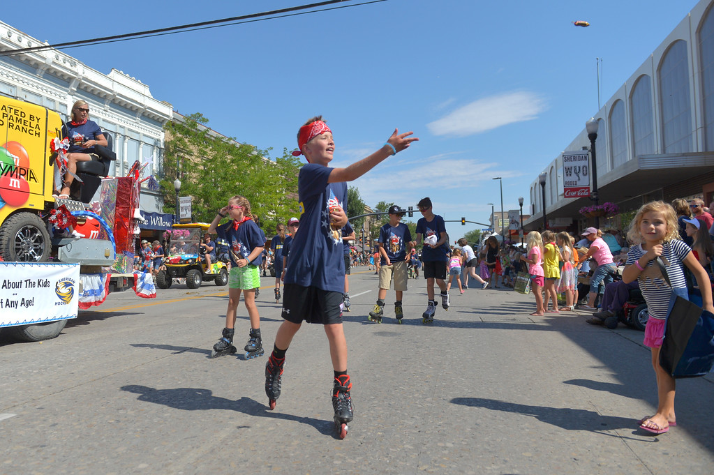 Justin Sheely | The Sheridan Press<br /> Sheridan Hockey kids toss candy during the Sheridan WYO Rodeo Parade Friday morning on Main Street.