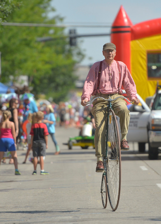 Justin Sheely | The Sheridan Press<br /> Rich Urbatchka rides a penny farthing during the Sheridan WYO Rodeo Parade Friday morning on Main Street.