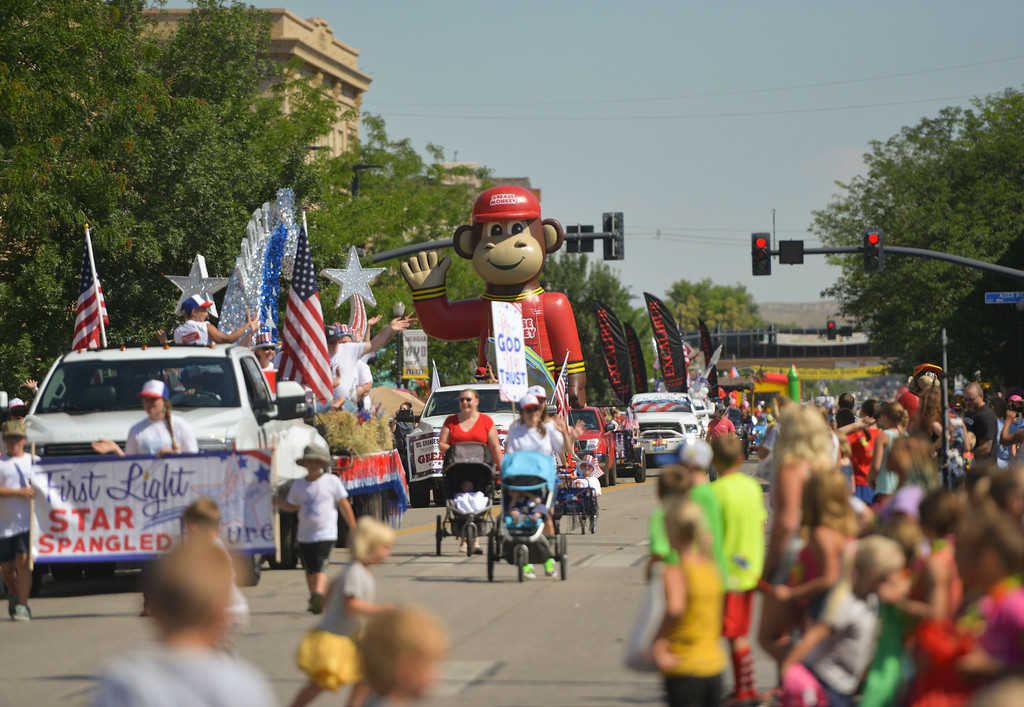 Justin Sheely | The Sheridan Press<br /> Parade floats make their way up the street during the Sheridan WYO Rodeo Parade Friday morning on Main Street.