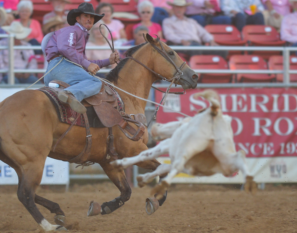 Justin Sheely | The Sheridan Press<br /> Jojo LeMond of Andrews, Texas, competes in steer roping during Thursday's Sheridan WYO Rodeo at the Sheridan County Fairgrounds.