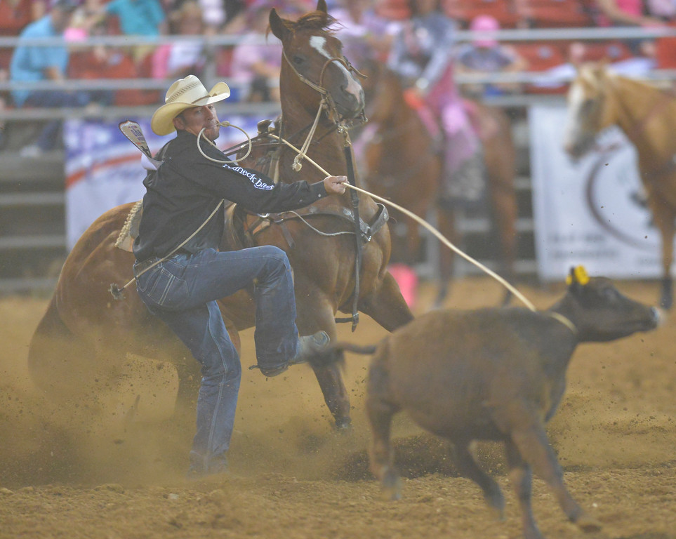 Justin Sheely | The Sheridan Press<br /> Hunter Herrin of Apache, Oklahoma, competes in tie-down during the Sheridan WYO Rodeo.
