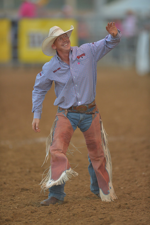 Justin Sheely | The Sheridan Press<br /> Local competitor Chet Johnson waves at the crowd after riding saddle bronc during Thursday's Sheridan WYO Rodeo at the Sheridan County Fairgrounds.