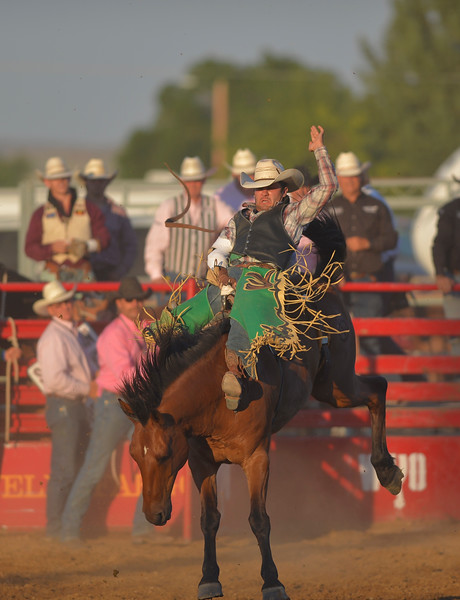 Justin Sheely | The Sheridan Press<br /> Local athlete Devan Reilly rides bareback for a 77 score during Thursday's Sheridan WYO Rodeo.