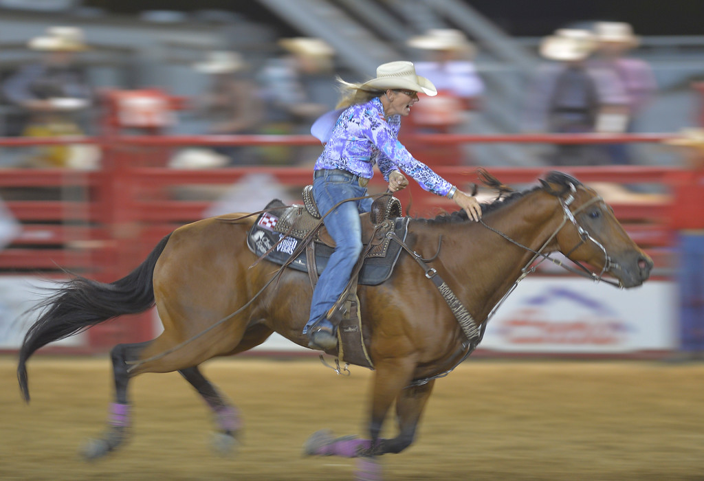 Justin Sheely | The Sheridan Press<br /> Jana Bean of Ft. Hancock, Texas, races back in barrel racing during the Sheridan WYO Rodeo Friday at the Sheridan County Fairgrounds.