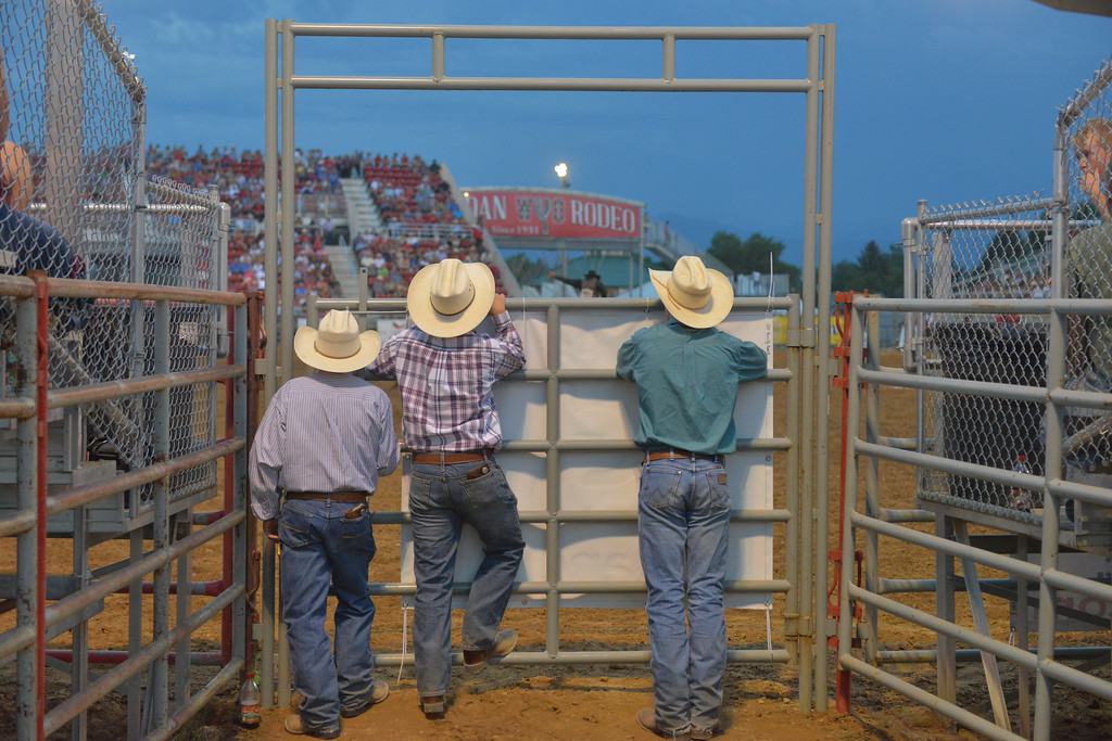 Justin Sheely | The Sheridan Press<br /> Cowboys find another vantage point to watch the action during the Sheridan WYO Rodeo Friday at the Sheridan County Fairgrounds.