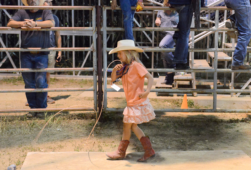 Justin Sheely | The Sheridan Press<br /> Eight-year-old Victoria Kordus plays with a rope during the Sheridan WYO Rodeo Friday at the Sheridan County Fairgrounds.