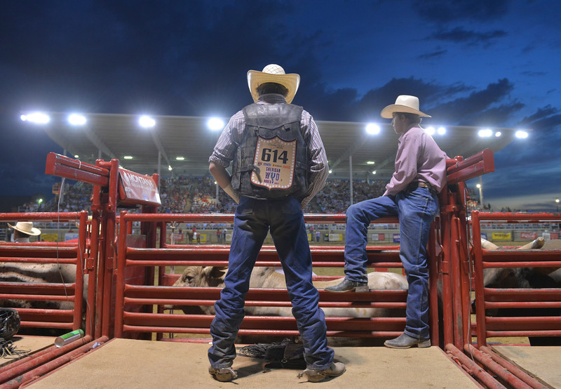 Justin Sheely | The Sheridan Press<br /> Bull riders wait behind the bucking chutes during the Sheridan WYO Rodeo Friday at the Sheridan County Fairgrounds.