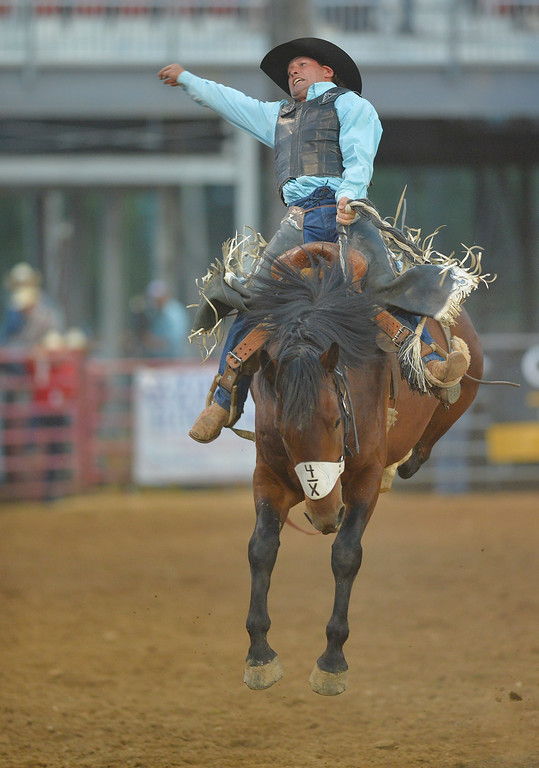 Justin Sheely | The Sheridan Press<br /> Colton Killer of Lance Creek, Wyoming, holds on the saddle as bucking horse Silver Screen gets some air during the Sheridan WYO Rodeo Friday at the Sheridan County Fairgrounds.