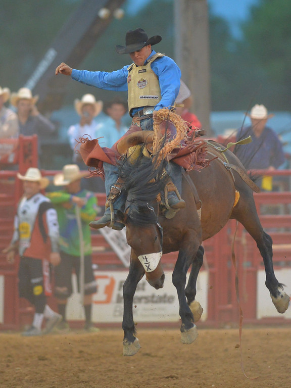 Justin Sheely | The Sheridan Press<br /> Audy Reed of Spearman, Texas, competes in saddle bronc riding during the Sheridan WYO Rodeo Friday at the Sheridan County Fairgrounds.