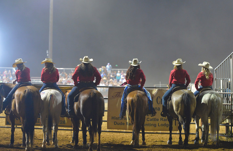 Justin Sheely | The Sheridan Press<br /> Sheridan WYO Rodeo Wranglers watch barrel racing during the Sheridan WYO Rodeo Friday at the Sheridan County Fairgrounds.