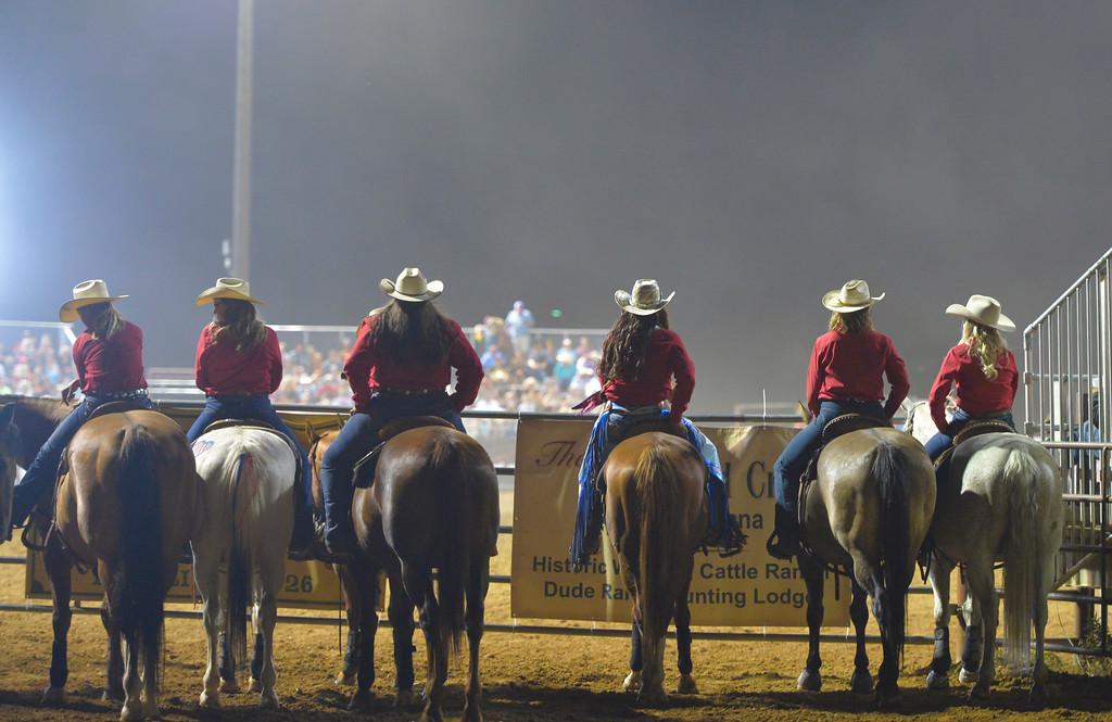 Justin Sheely | The Sheridan Press<br /> Sheridan WYO Rodeo Wranglers watch barrel racing during the Sheridan WYO Rodeo Friday at the Sheridan County Fairgrounds.
