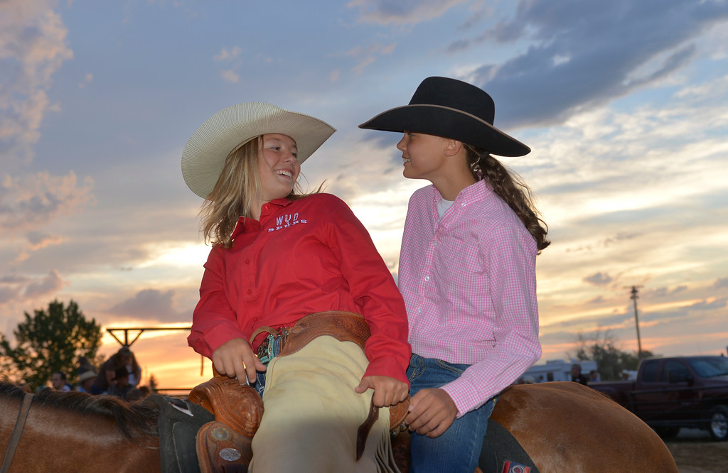 Justin Sheely | The Sheridan Press<br /> Rodeo Wrangler Sierra Power, left, visits with Meghan Anthony during the Sheridan WYO Rodeo Friday at the Sheridan County Fairgrounds.