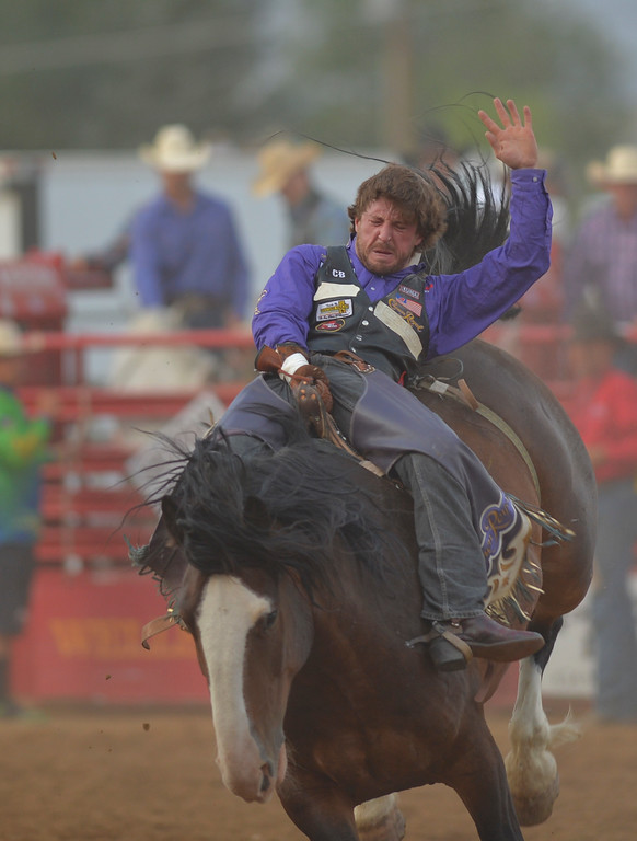 Justin Sheely | The Sheridan Press<br /> Tilden Hooper competes in bareback riding during the Sheridan WYO Rodeo Friday at the Sheridan County Fairgrounds.